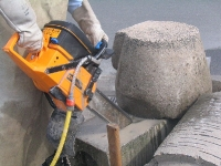 Chainsaw cutting concrete