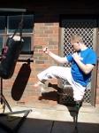 Front kick, real leg, post-bag impact