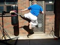 Jumping round kick, impact