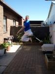 Jumping spinning kick, mid-air, end of circle