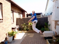 Jumping spinning kick, mid-air