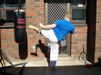 Round kick, artificial leg, part-way through